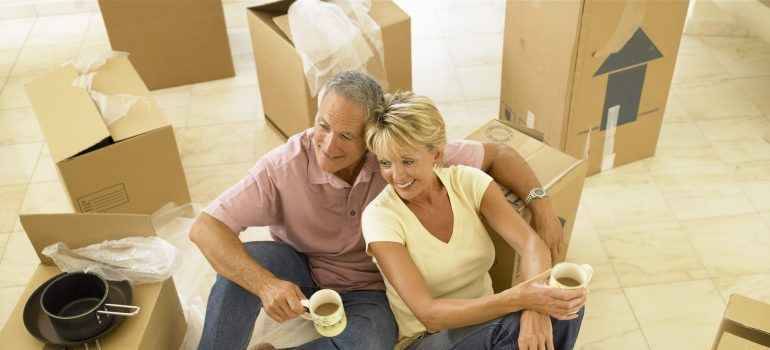 moving services PA - an older couple with the moving boxes