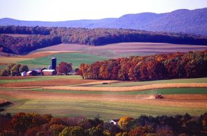 Wonderful Pennsylvania nature with rural buildings in the distance.