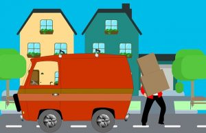 Unloading items from a moving van.