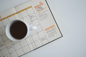 A cup of coffee on a planner.