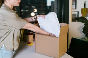 A woman packing clothes